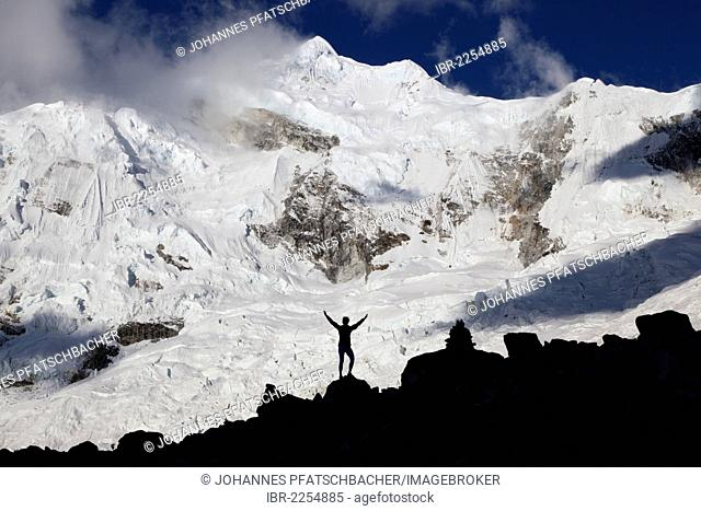 Silhouette of a woman standing in front of Nevado Chopicalqui mountain, Cordillera Blanca mountain range, Andes, Peru, South America