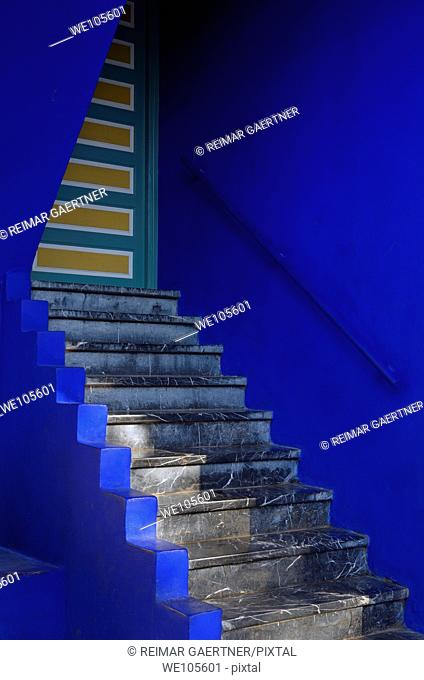 Stairs and door at the cobalt blue Islamic Art Museum of Marrakech at Majorelle Garden Morocco