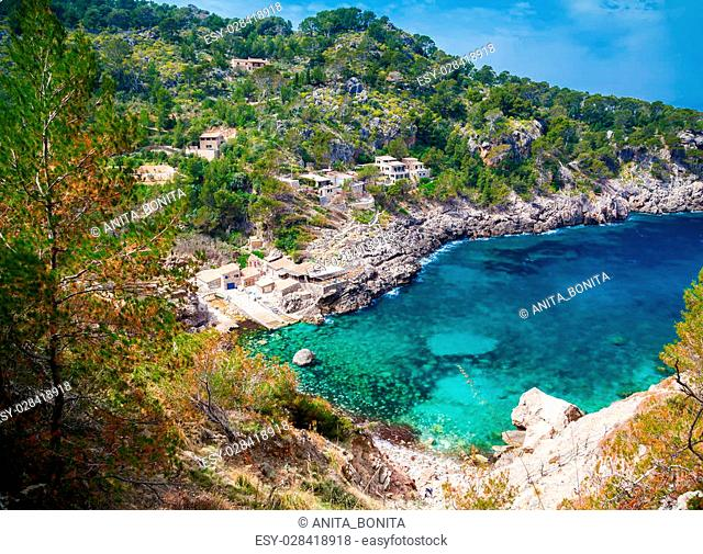 beautiful aerial view of the beach Cala de Deia with azure sea, Mallorca, Spain