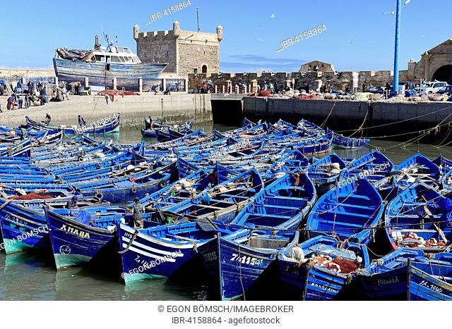 Old blue fishing boats in the harbor, Essaouira, UNESCO World Heritage Site, Morocco