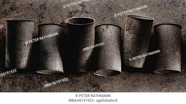 Tin cans, old, rusty, in a row
