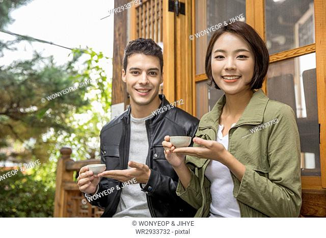 Smiling couple at teahouse