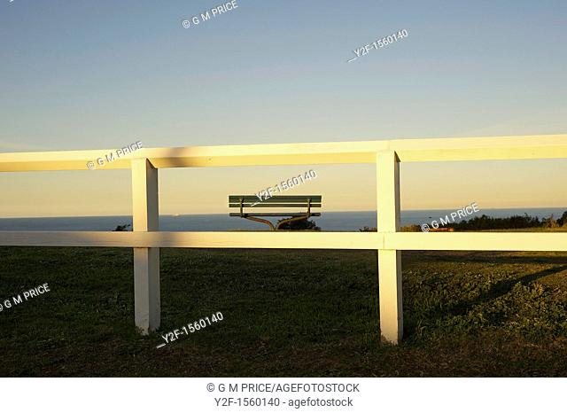 white fence by the sea