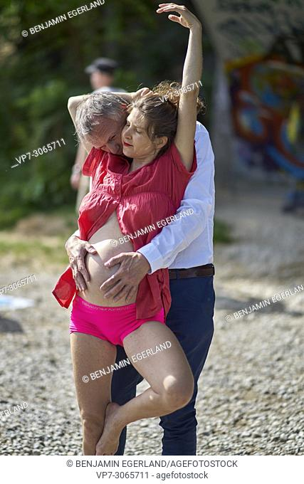 Sensual couple, pregnancy, romantic, age difference, love. Munich, Germany