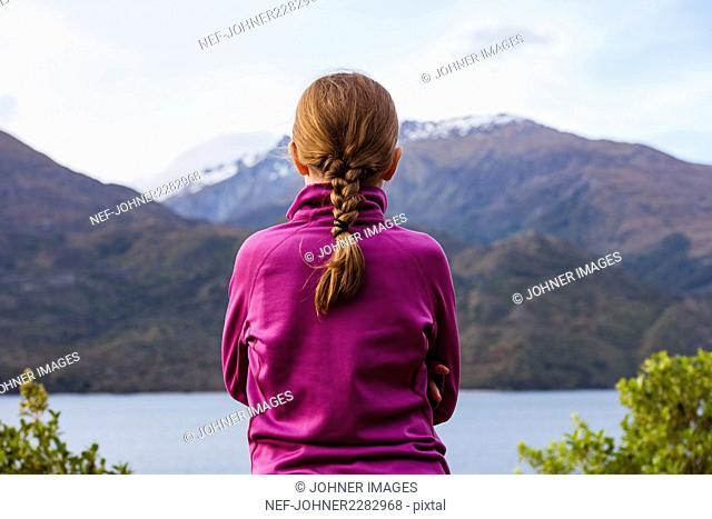 Girl looking at view