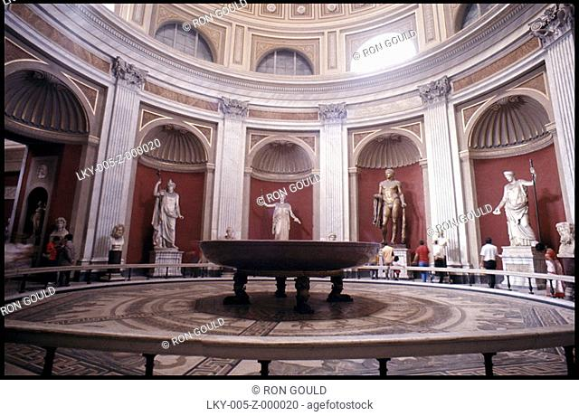 Classical statues in ornate museum display