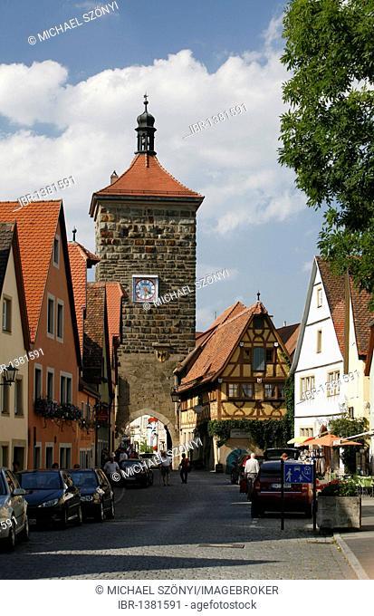 Historic buildings in the Spitalgasse, Sieberturm tower at back, historic town of Rothenburg ob der Tauber, Bavaria, Germany, Europe