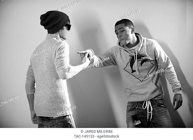 """Justin Bieber and Quincy Brown (r) on set of Quincy Brown """"""""Stay Awhile"""""""" music video in Los Angeles, California"""