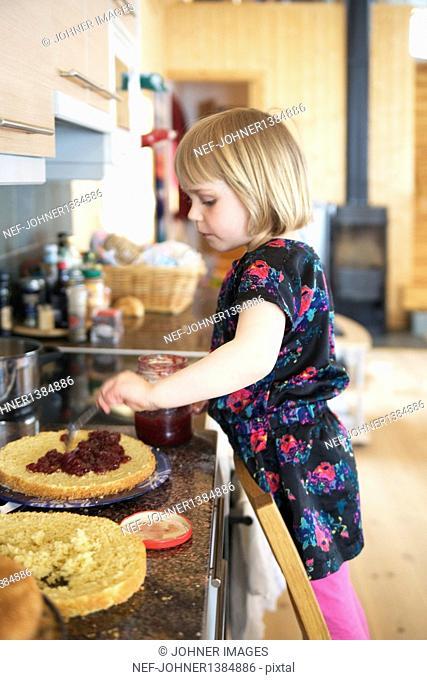 Girl preparing cake