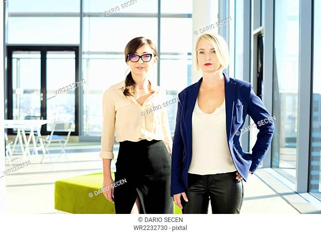 Portrait of two female architects in modern office