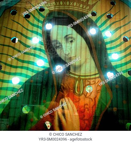 An image of Our Lady of Guadalupe decorated with lights decorates a home in Mexico City, Mexico