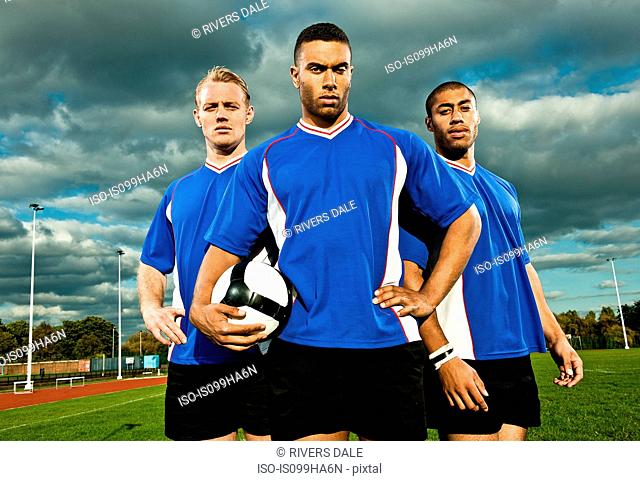 Soccer players on pitch, portrait