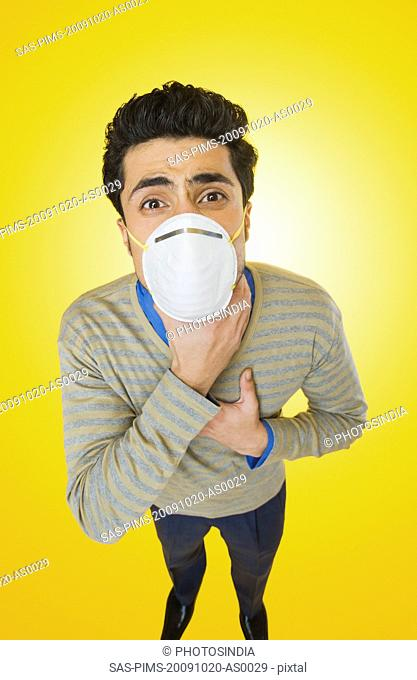 Businessman wearing pollution mask