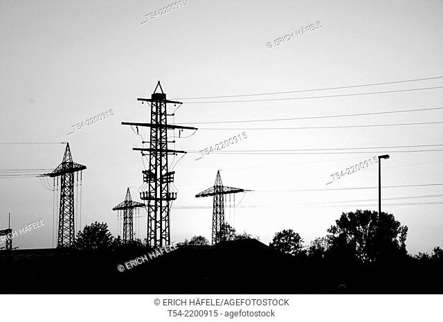 Electricity pylons against the sunset