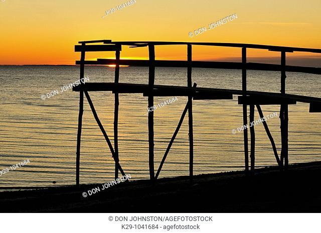 Wooden pier on Lake Winnipeg at dawn