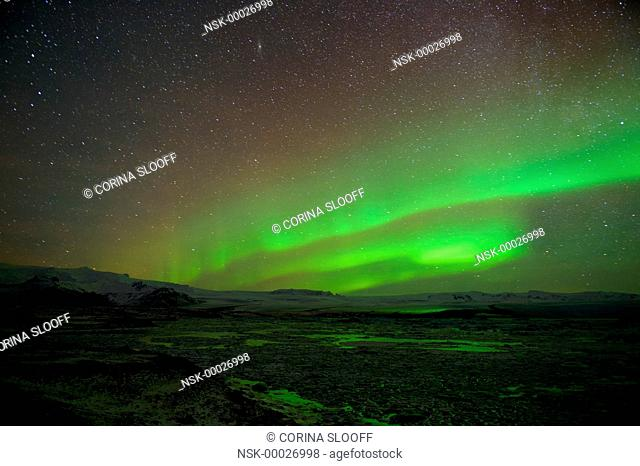Aurora borealis over a glacier and its lake, Iceland, Jokulsarlon
