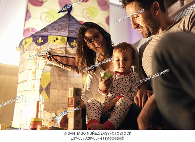 Parents enjoying playing with their son at home. Family Concept