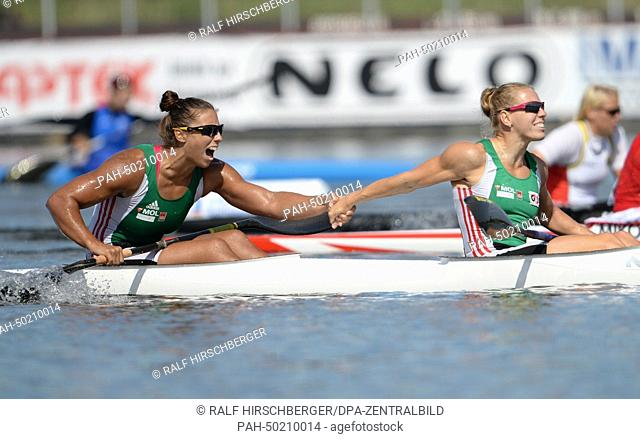 Hungarian Gabriella Szabo (R) and Tamara Csipes cheer after the canoe double over 500 meters at the European Canoeing Championships on Lake Beetzsee in...
