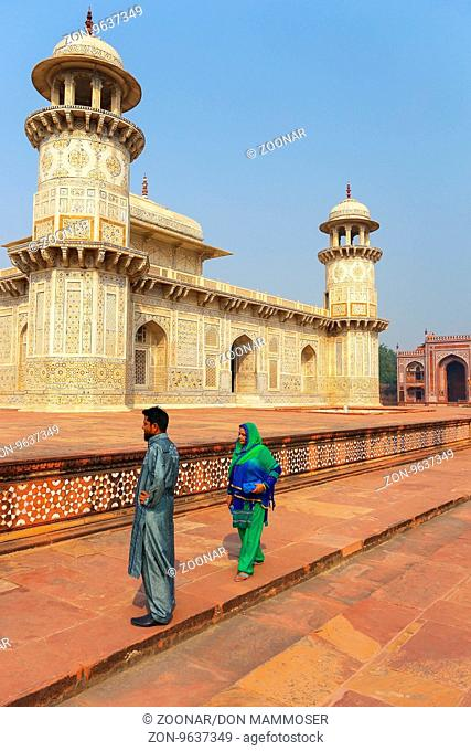 Local tourists walking around Tomb of Itimad-ud-Daulah in Agra, Uttar Pradesh, India. This Tomb is often regarded as a draft of the Taj Mahal