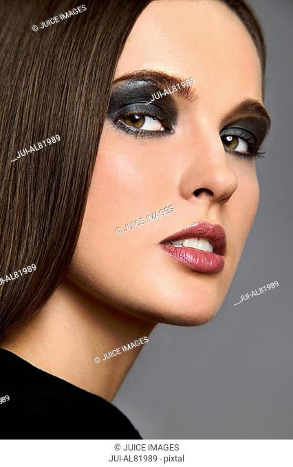 Studio shot of woman with dark eye makeup