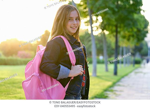 Blond kid student girl with backpack in the park