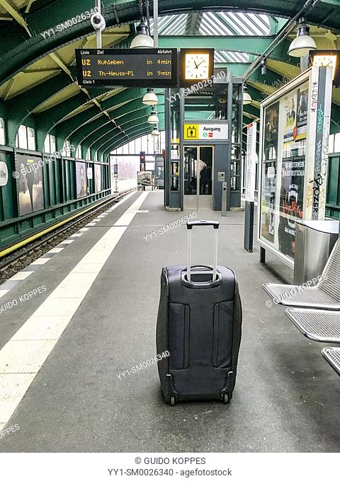 Berlin, Germany. Lonely suitcase, abandoned and depressed, waiting at an S-Bahn Platform for it's owner to take it on an international journey back home