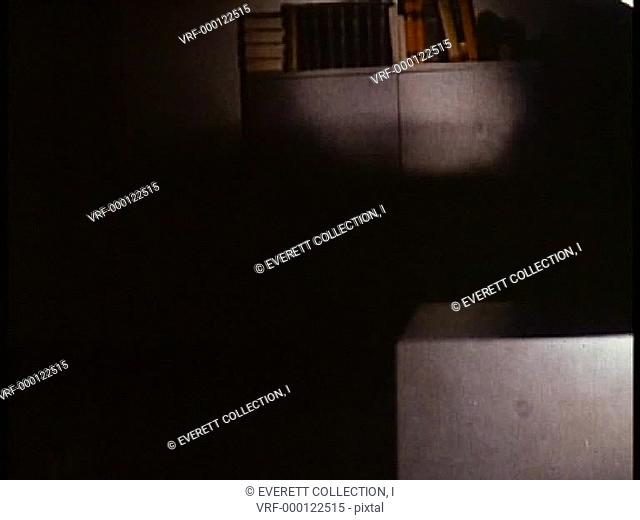 View of flashlight shining on objects in office