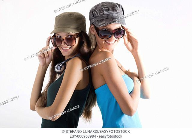 Trendy teenage girls on white background