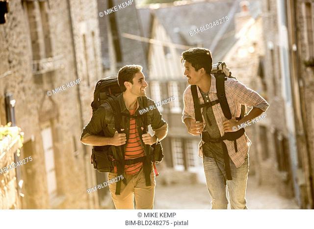 Men backpacking in city