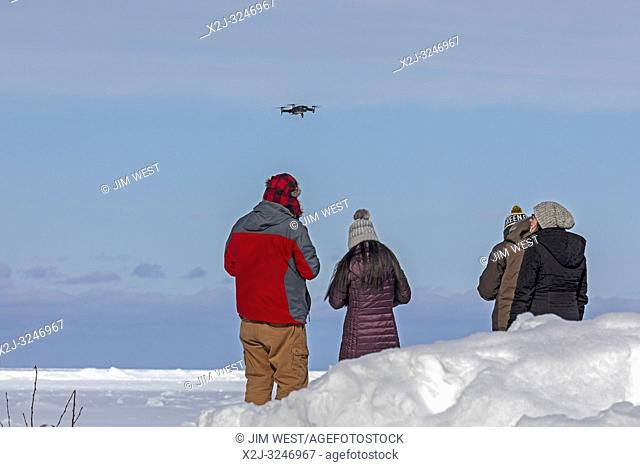 Munising, Michigan - A man illegally flies a drone at the edge of Lake Superior in Pictured Rocks National Lakeshore. Drones are not permitted in U. S
