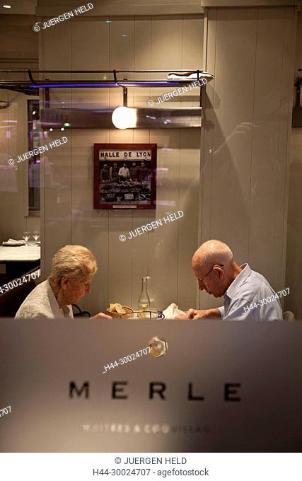 Old retired couple in Merle Sea Food restaurant in Les Halles de Lyon Paul Bocuse , Gourmet market, Lyon, Rhone Alps, France