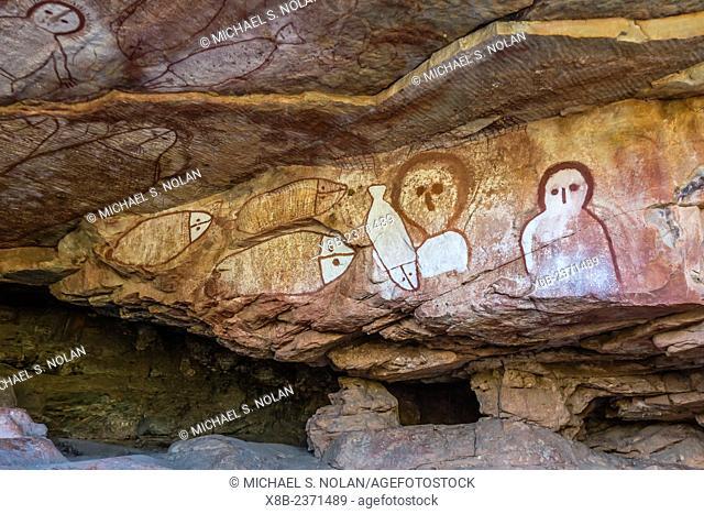 Aboriginal Wandjina cave artwork in sandstone caves at Raft Point, Kimberley, Western Australia, Australia