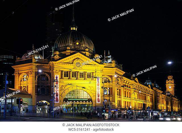 flinders street railway station in central melbourne city australia at night
