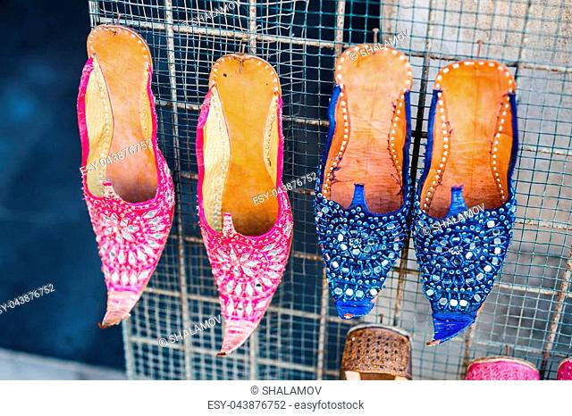 Traditional colorful slippers for sale at Souq Waqif arabic market in Doha