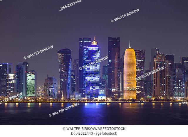 Qatar, Doha, Doha Bay, West Bay skyscrapers dawn, with World Trade Center in blue and Burj Qatar in gold