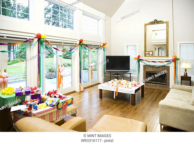 Party decorations and gifts in living room