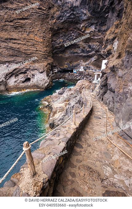 Hidden houses in the tourist attraction pirate cave of El Poris de Candelaria, in La Palma island, Canary islands, Spain