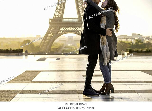 Couple embracing at Eiffel Tower