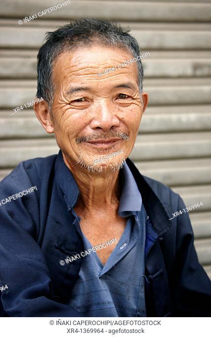 Portrait of man , Market Rongjiang, Rongjiang, Guizhou, China