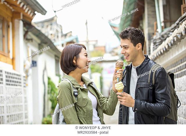 Young smiling couple visiting Korean village