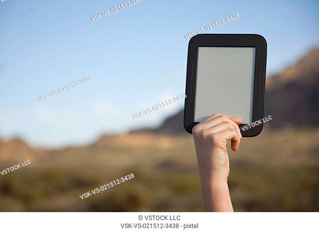 USA, Arizona, Phoenix, Hand holding digital tablet in mountain area