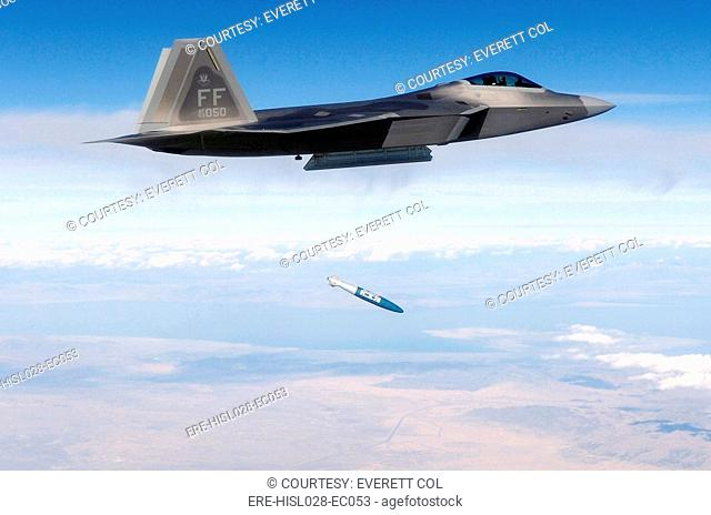 F-22 Raptor releases a 1 000-pound over the Utah Test and Training Range during weapons evaluation. October 20 2005. BSLOC-2011-12-219