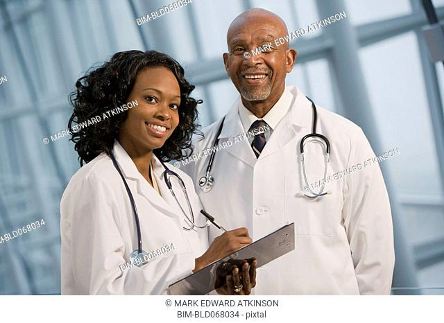 African doctors smiling with medical chart