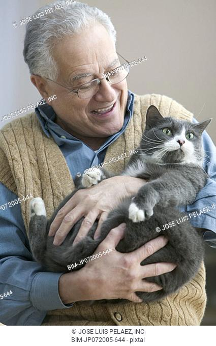 Older man holding his cat