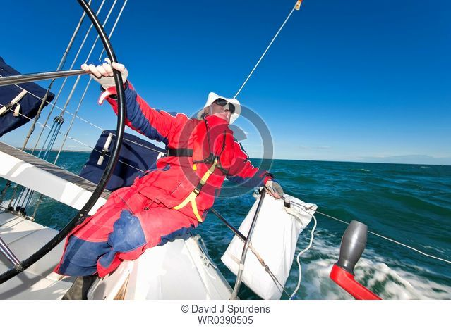 Captain at the wheel of ocean going yacht