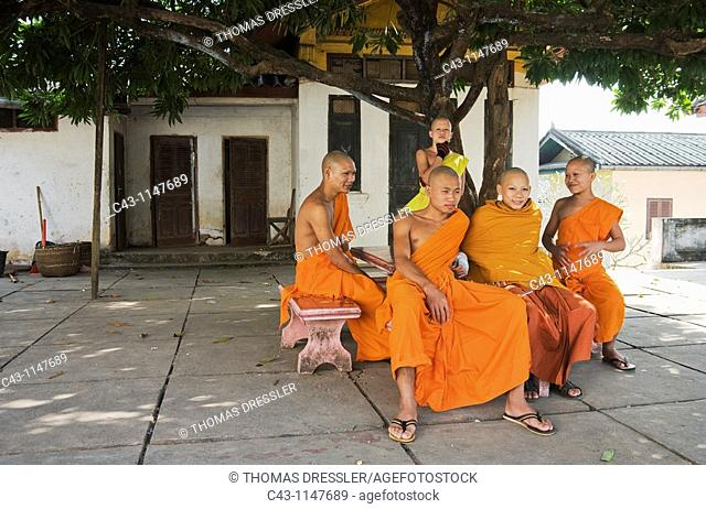 Laos - A group of Buddhist novices at leisure in the Buddhist monastery of Vat Souvannakhili in Luang Prabang  In 1995 Luang Prabang was declared UNESCO World...
