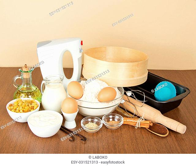 Products, set of spices, raisin and baking dish, on a beige background