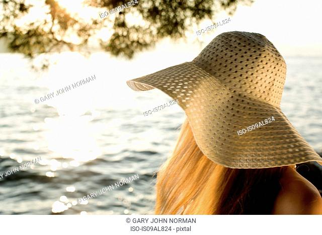 Young woman in sunhat at coast, Milna, Brac, Croatia