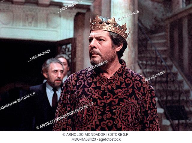 Italian actor Marcello Mastroianni - as the emperor Henry IV - with Italian actor Leopoldo Trieste behind him on the set of the film Henry IV. 1983