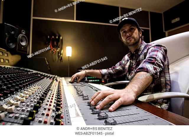 Man working in the control room of a recording studio